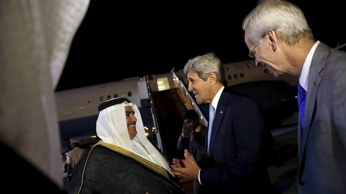Bahrain's Foreign Minister Khalid bin Ahmed Al Khalifa (L) and U.S. Ambassador to Bahrain William Roebuck (R) greet US Secretary of State John Kerry. (Reuters)