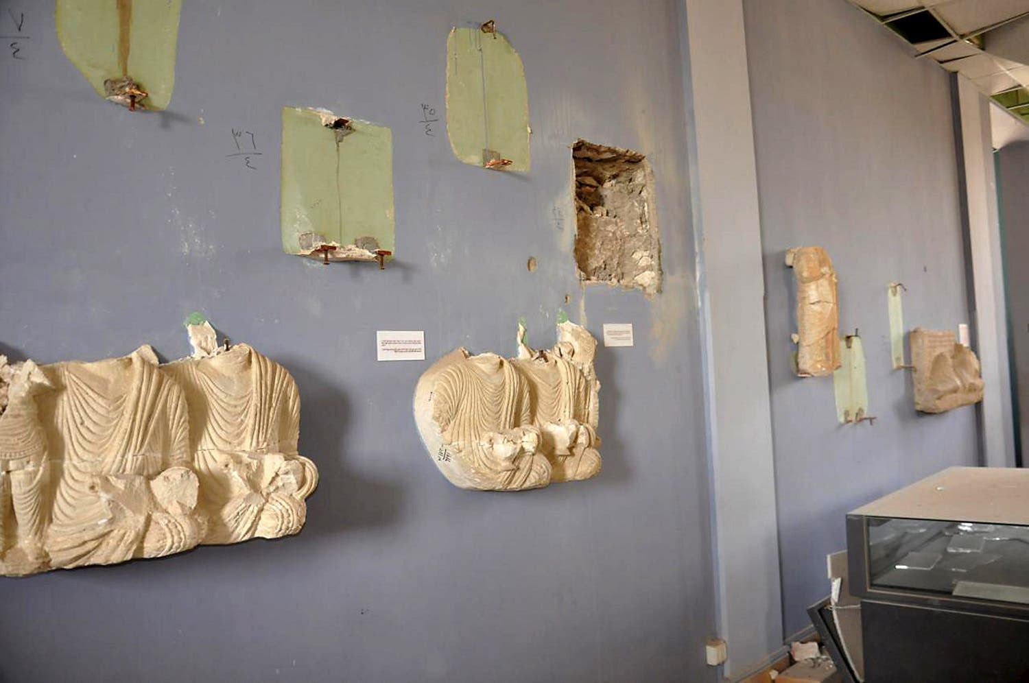 A view shows damaged artefacts inside the museum of the historic city of Palmyra, after forces loyal to Syria's President Bashar al-Assad recaptured the city, in Homs Governorate in this handout picture provided by SANA on March 27, 2016. REUTERS/SANA