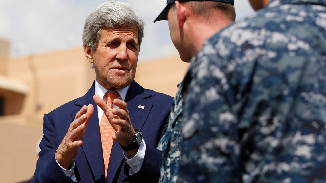 Secretary of State John Kerry meets with officers from the U.S. Navy's Fifth Fleet as he tours the Naval Support Activity Bahrain base in the Gulf, in Manama, Bahrain. (AP)