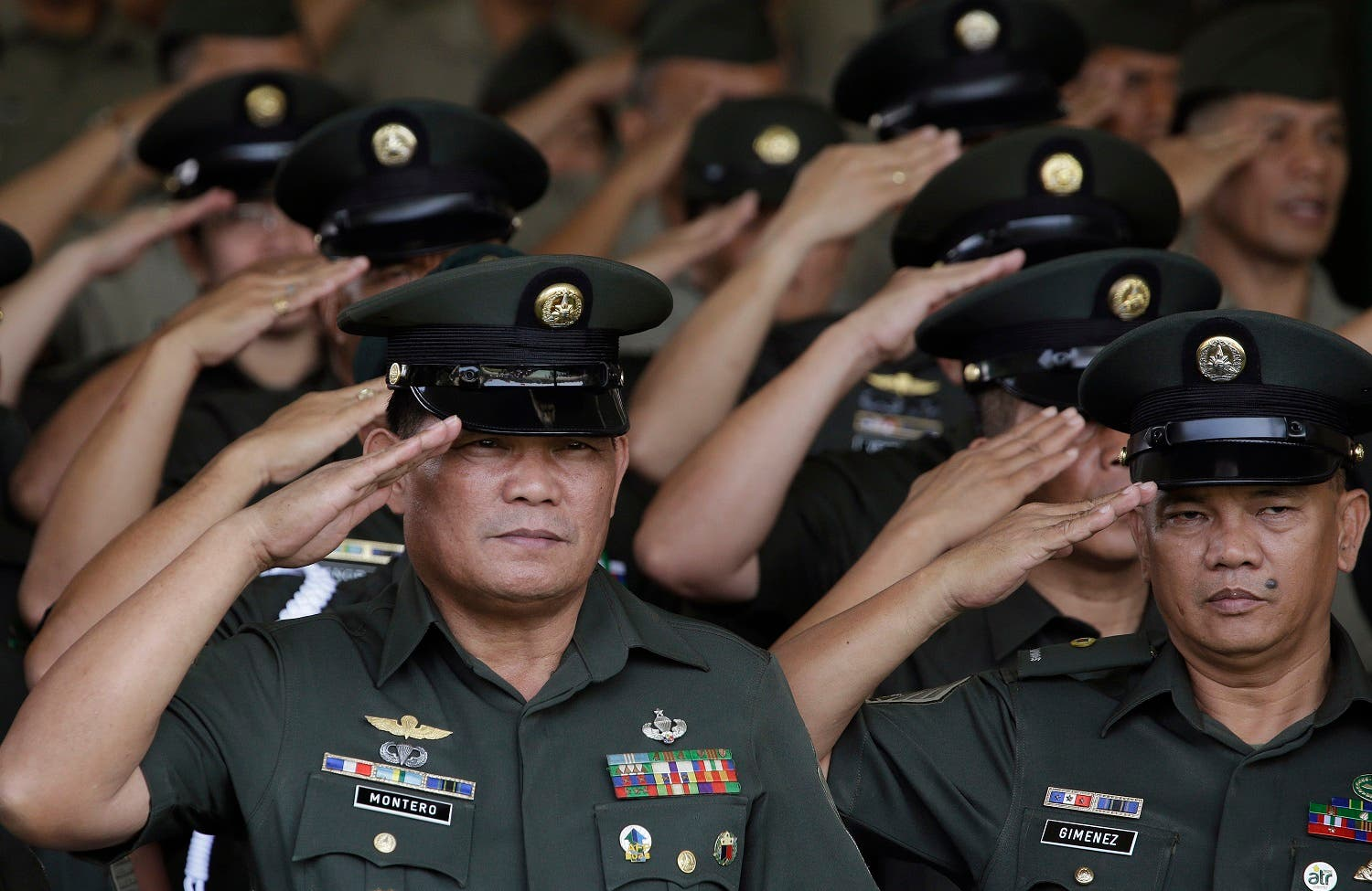 Philippine Army officers salute during ceremonies at the 119th founding anniversary of the Philippine Army in suburban Taguig, south of Manila, Philippines on Tuesday, March 22, 2016. Under the administration of Philippine President Benigno Aquino III, the Philippine military continues to it's modernization program as it deals with major security concerns, including Communist and Muslim insurgencies and South China Sea territorial disputes involving China, the Philippines and four other governments. (File photo: AP)