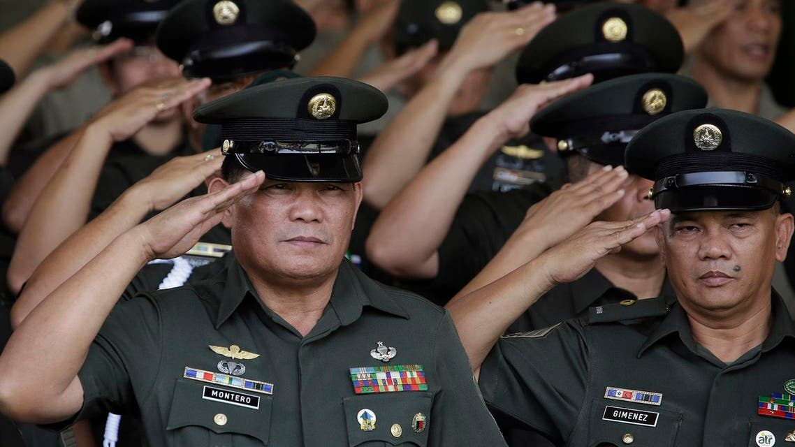Philippine Army officers salute during ceremonies at the 119th founding anniversary of the Philippine Army in suburban Taguig, south of Manila, Philippines on Tuesday, March 22, 2016. Under the administration of Philippine President Benigno Aquino III, the Philippine military continues to it's modernization program as it deals with major security concerns, including Communist and Muslim insurgencies and South China Sea territorial disputes involving China, the Philippines and four other governments. (AP Photo/Aaron Favila)