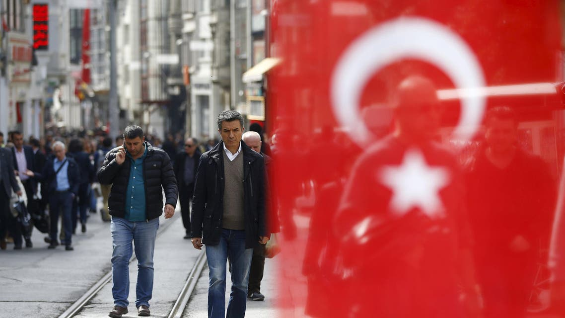 People stroll at Istiklal street, a major shopping and tourist district, in central Istanbul, Turkey March 22, 2016.
