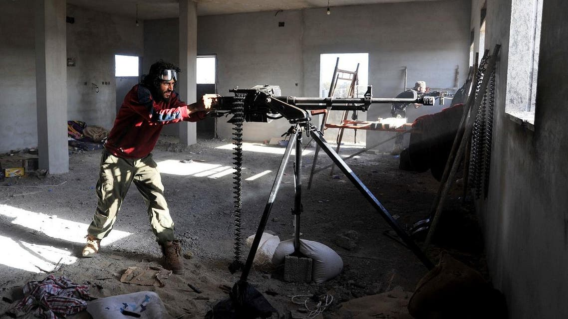 In this picture taken Thursday, March 10, 2016, fighters against the Islamic State group fire weapons in the Hawari area, south-west of the city of Benghazi, Libya. (AP)