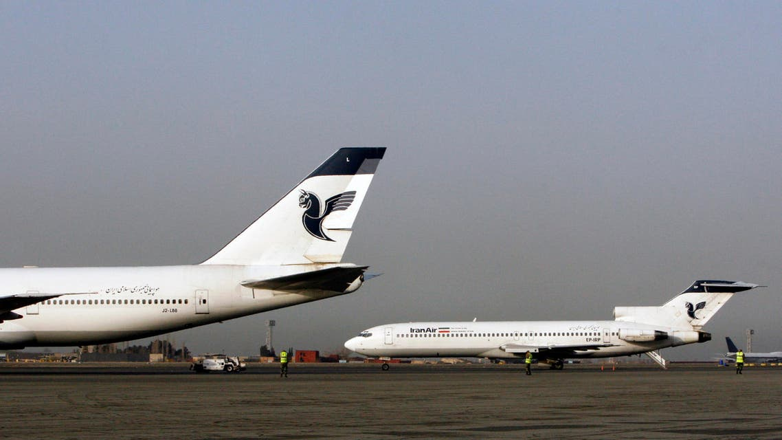 In this Sunday, March 2, 2008 photo, two passenger planes of Iran's national air carrier, Iran Air, are parked at the Mehrabad Airport in Tehran, Iran.
