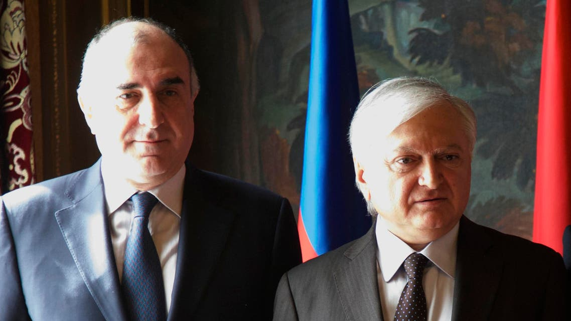 Azerbaijan's Foreign Minister Elmar Mammadyarov, left, and his Armenia's counterpart Eduard Nalbandian pose for a family photo during the CIS foreign ministers meeting in Moscow, Russia, on Friday, April 8, 2016.