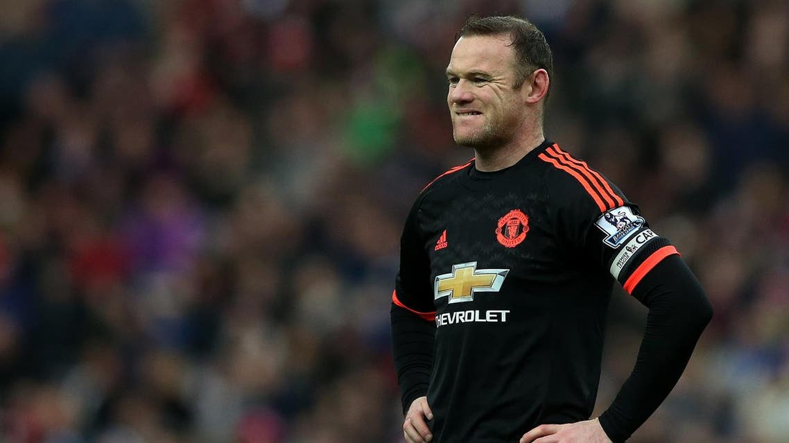 Manchester United's captain Wayne Rooney stands dejected as Sunderland's Wahbi Khazri celebrates his goal during the English Premier League soccer match between Sunderland and Manchester United at the Stadium of Light, Sunderland, England, Saturday, Feb. 13, 2016. (AP)
