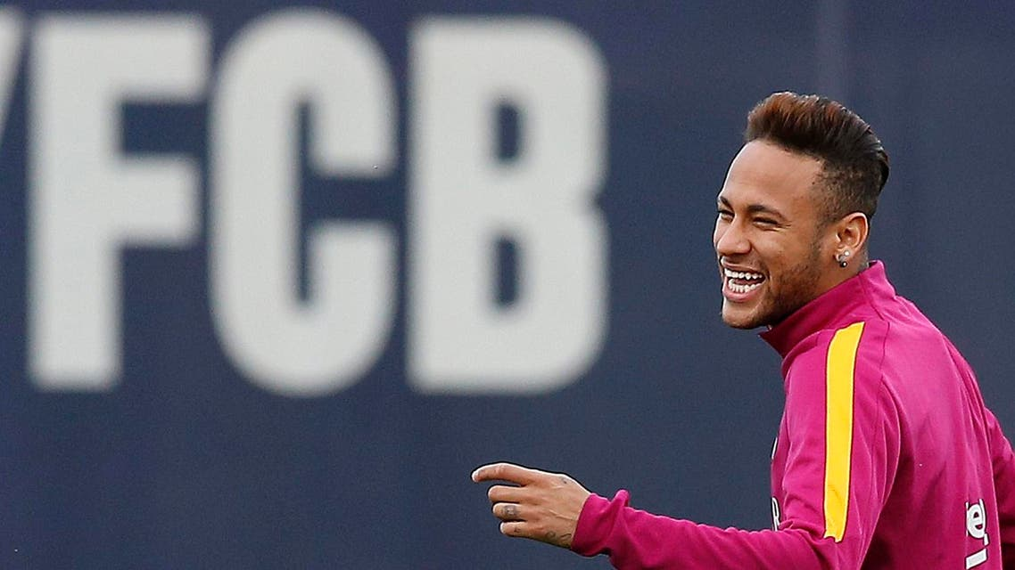 FC Barcelona's Neymar smiles during a training session at the Sports Center FC Barcelona Joan Gamper in San Joan Despi, Spain, Friday, April 1, 2016. FC Barcelona will play against Real Madrid Saturday in a Spanish La Liga soccer match, dubbed 'el clasico'. (AP Photo/Manu Fernandez)