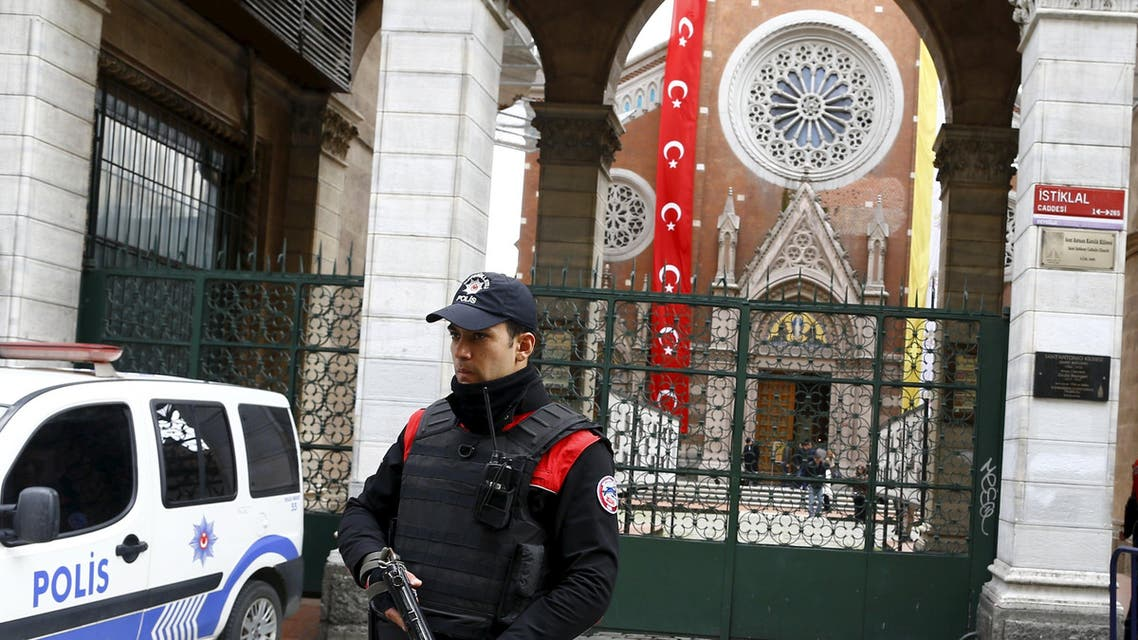 A Turkish police officer stands guard in front of St Antouan Church at Istiklal Street in Istanbul, Turkey March 27, 2016. REUTERS/Osman Orsal
