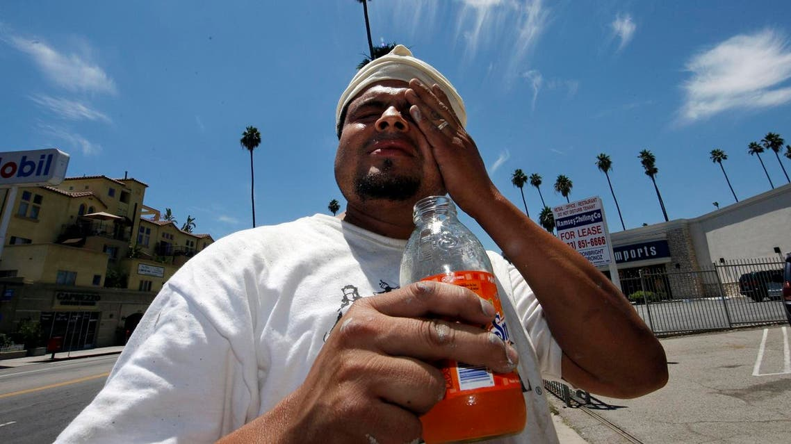 Wilfredo Aguilar wipes sweat from his forehead as he takes a break from painting a building under the hot sun on Hollywood Boulevard in Los Angeles, Thursday, June 19, 2008. Southern California roasted Thursday in a record-breaking, end-of-spring heat wave that sent temperatures soaring past 100 degrees in many areas, posing hazards for anyone who ventured outside. (AP)
