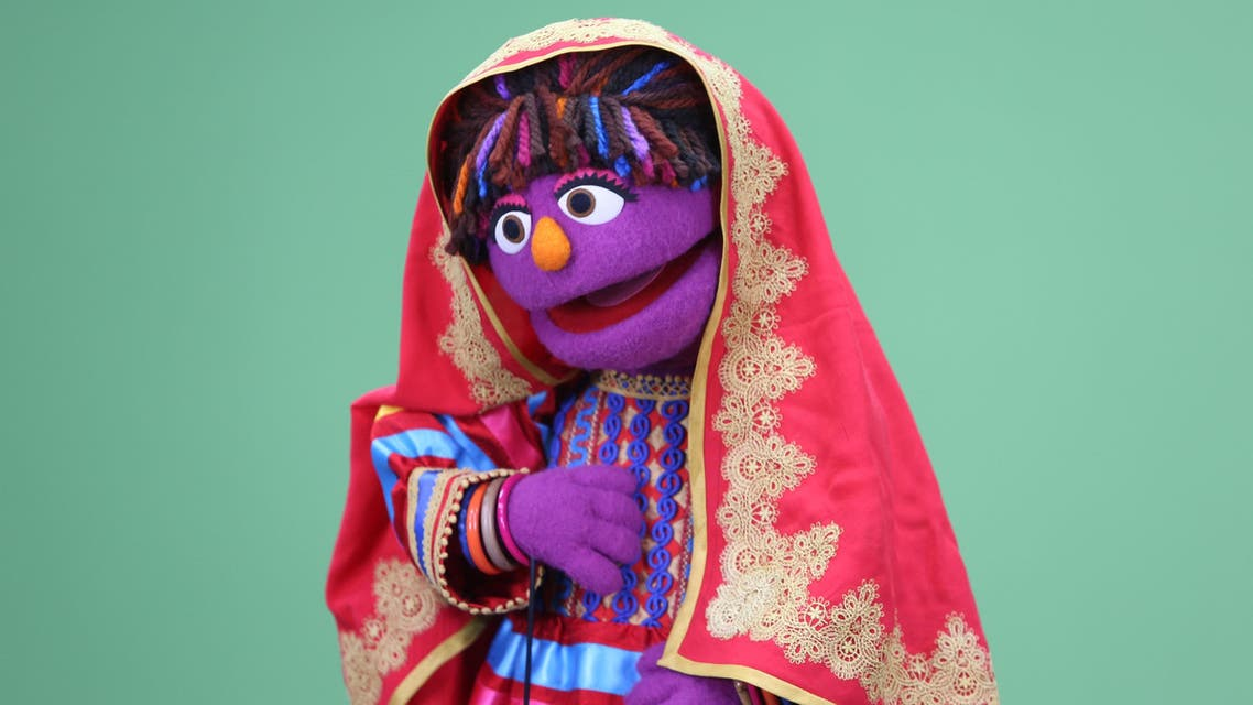 In this Wednesday, April 6, 2016 photo, Sesame Street's new Afghan character, a sassy, fun 6-year-old Afghan puppet girl called Zari takes part in a recording session ahead of her television debut on Afghanistan's local production of the show in Kabul, Afghanistan.