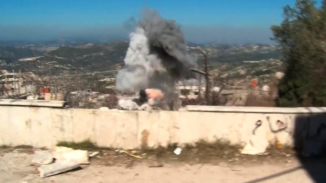 In this frame grab made from the Russian Defense Ministry Press Service, an artillery shell explodes about 150 meters away from a group of journalists in the Syrian village of Kinsibba, about 5 kilometers from Turkey border onTuesday, March 1, 2016. A series of artillery shells exploded on the main street of Kinsibba, sending a group of international reporters running for cover and underscoring the limits of Syria's partial cease-fire. (AP Photo/Russian Defense Ministry Press Service pool photo via AP)