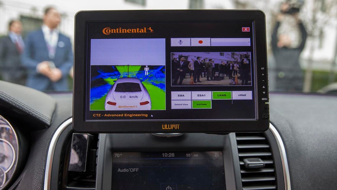 A display inside a Tesla Model 90D during a demonstration of self driving car technology on Capitol Hill, on Tuesday, March 15, 2016, in Washington. (AP Photo/Evan Vucci)
