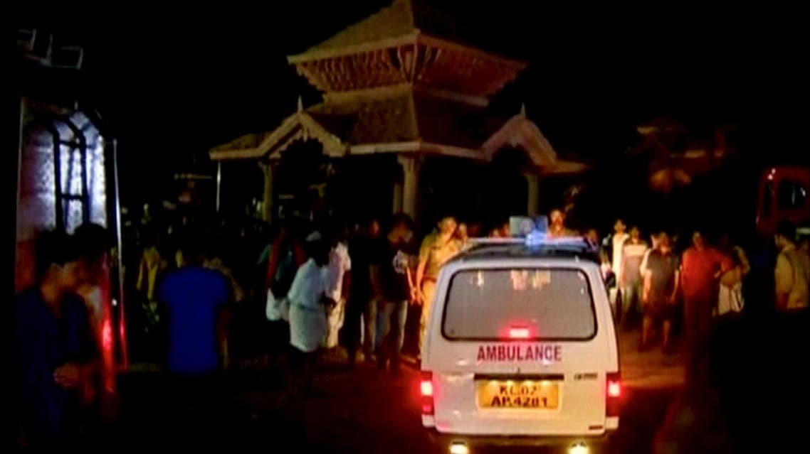 An ambulance is seen next to people after a fire broke out as people gathered for a fireworks display at a temple in Kollam, southern India, in this still image taken from video April 10, 2016. REUTERS/ANI via REUTERS