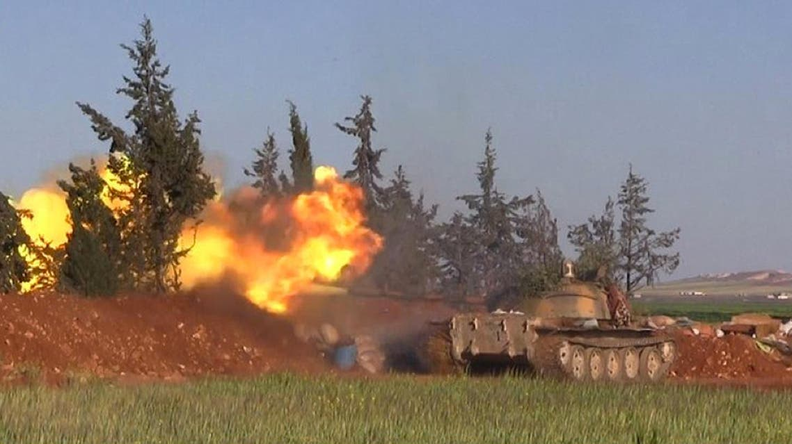 This image posted on the Twitter page of Syria's al-Qaida-linked Nusra Front on Friday, April 1, 2016, shows Nusra Front tank fires at Syrian troops and pro-government gunmen in the northern village of al-Ais in Aleppo province, Syria. ap