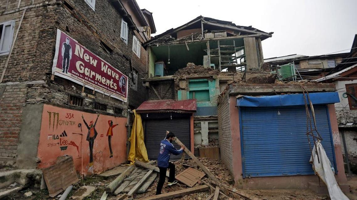 A man clears debris after his house partially collapsed following an earthquake, in Srinagar, India April 10, 2016 (Reuters)