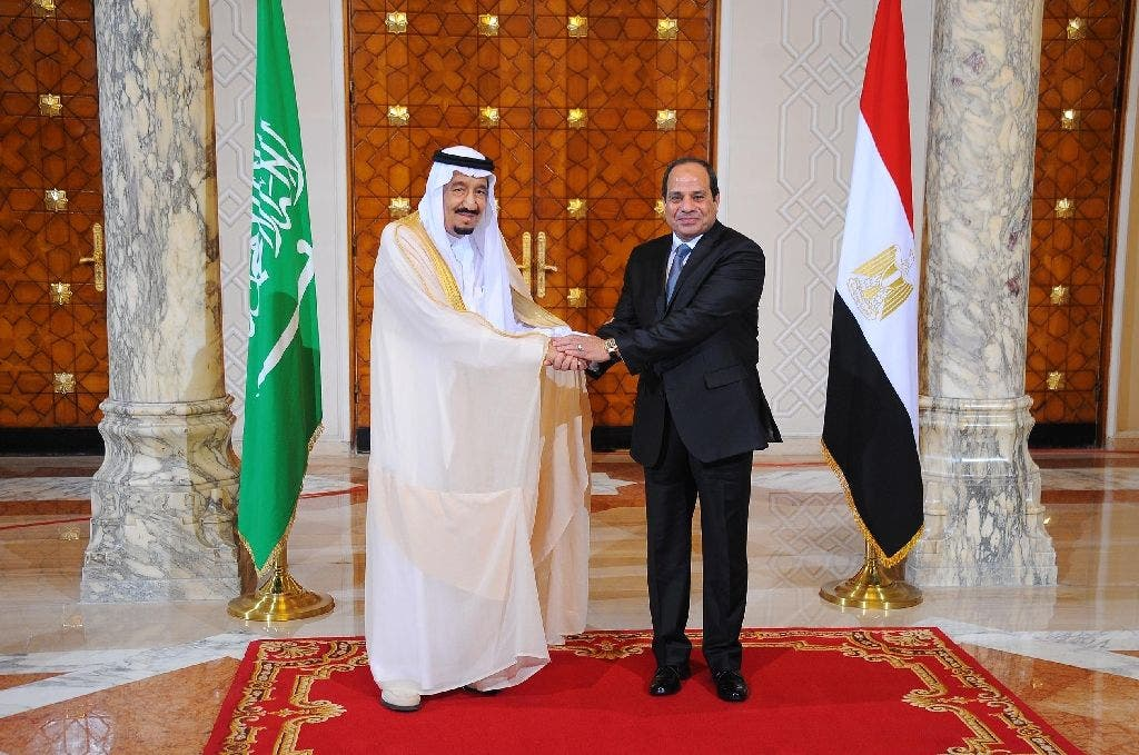 A picture released by the Egyptian Presidency on April 7, 2016 shows Egyptian President Abdel Fattah al-Sisi (R) meeting with Saudi King Salman bin Abdulaziz in the capital Cairo (AFP)