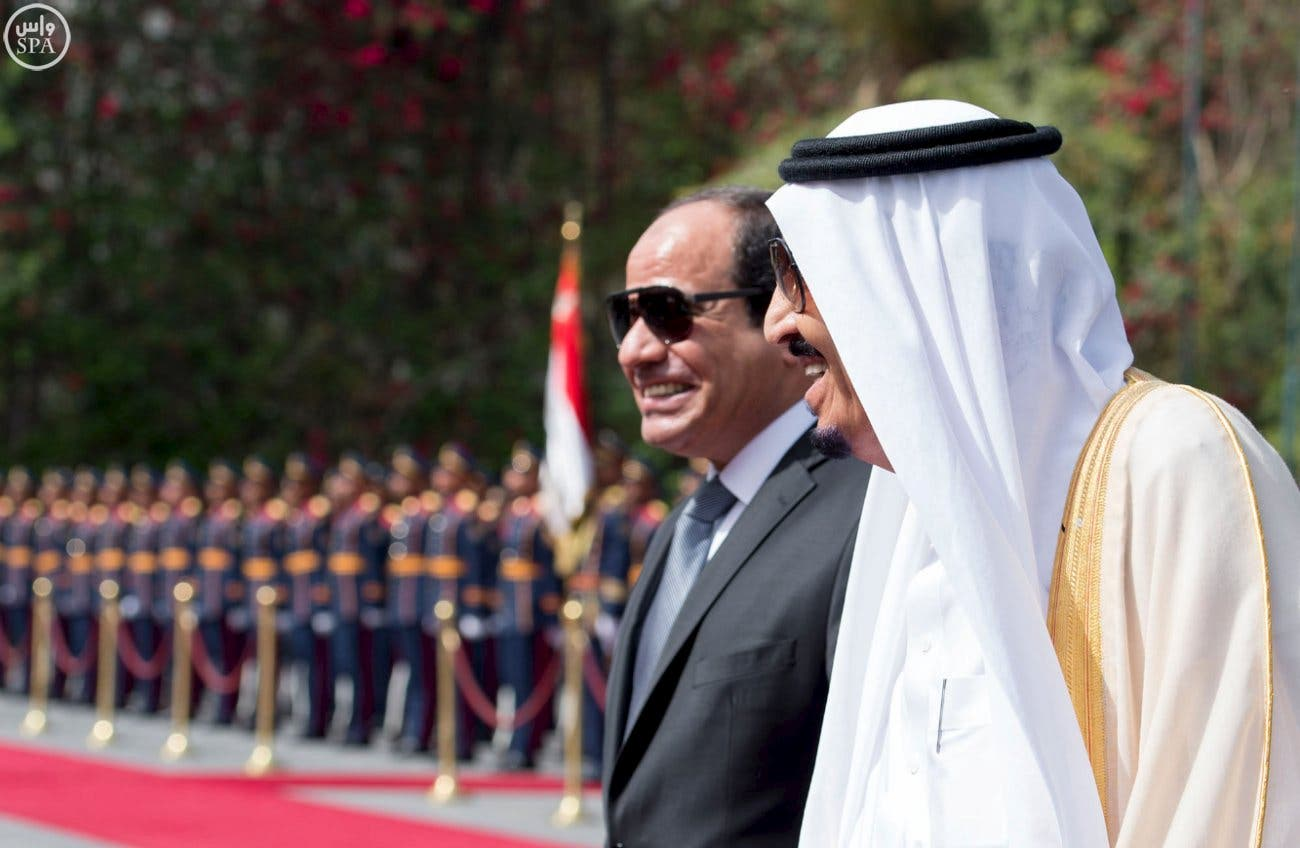 Egypt's President Abdel Fattah al-Sisi and Saudi Arabia's King Salman review the honour guards in Cairo, Egypt, in this handout photo received April 7, 2016.
