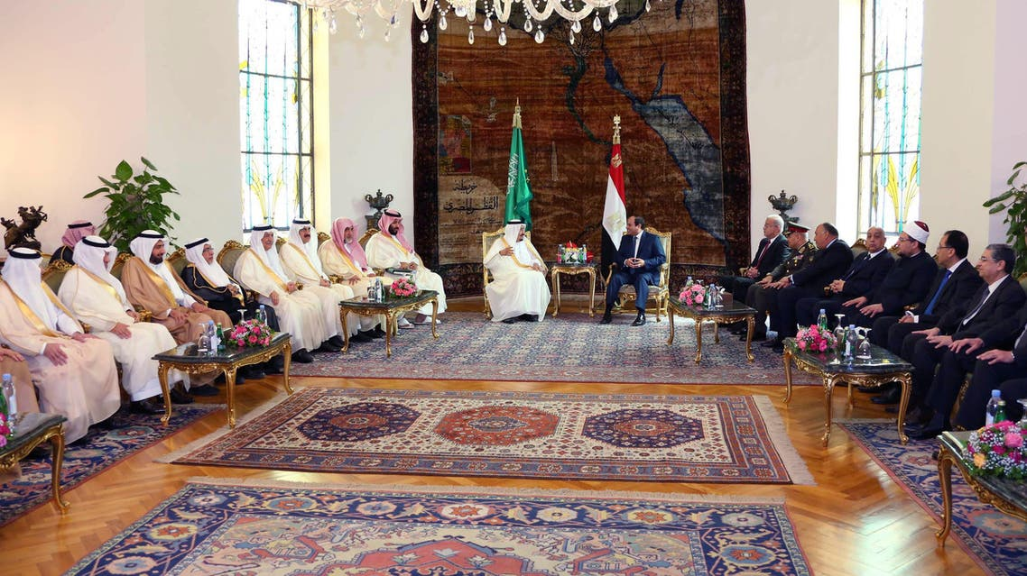In this picture taken Friday, April 8, 2016, provided by the office of the Egyptian Presidency, Egyptian President Abdel-Fattah el-Sissi, right, sits with Saudi Arabia's King Salman in Cairo, surrounded by delegations from the two countries. (AP)