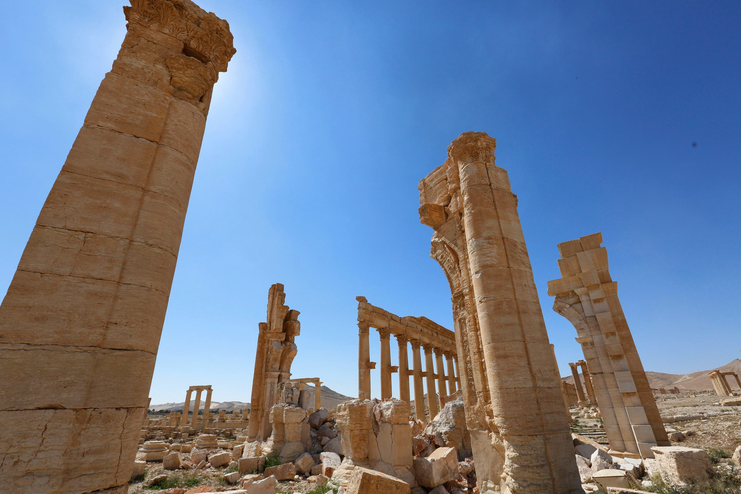 In this picture taken Friday, April 1, 2016, damage is seen near the Arch of Triumph in the ancient city of Palmyra in the central city of Homs, Syria.  (AP)