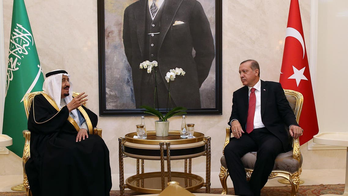 Turkish President Recep Tayyip Erdogan, right, and Saudi Arabia's King Salman speak at Esenboga Airport in Ankara, Turkey, Monday, April 11, 2016. (AP)