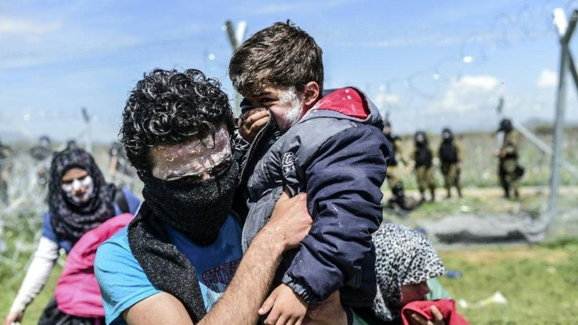 There are an estimated 11,000 migrants and refugees stranded at the flashpoint Idomeni crossing, many of them fleeing war in Syria and Iraq (AFP)