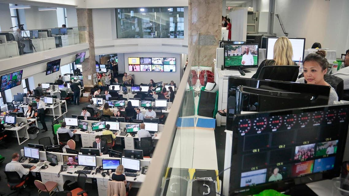 Happier days: Staffers work in the Al Jazeera America newsroom after the network's first broadcast on Tuesday, Aug. 20, 2013 in New York (File Photo: AP)