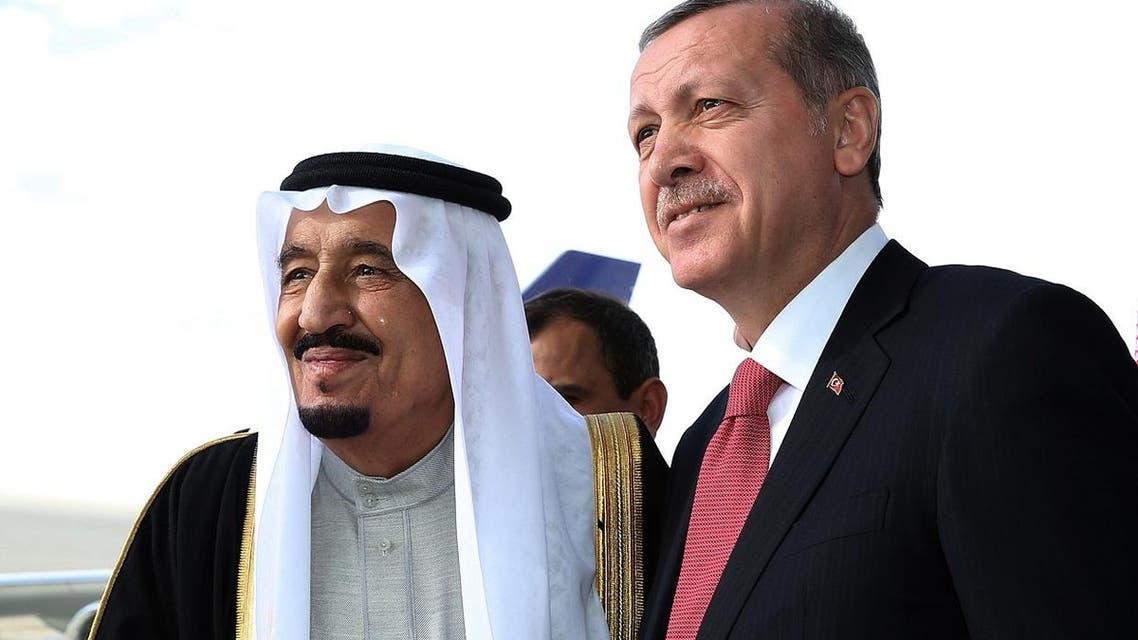 Turkish President Recep Tayyip Erdogan, right, and Saudi Arabia's King Salman shake hands during a ceremony at Esenboga Airport in Ankara, Turkey, Monday, April 11, 2016. The King is in Turkey for a three-day official visit. (Murat Cetinmuhurdar, Presidential Press Service, Pool via AP)