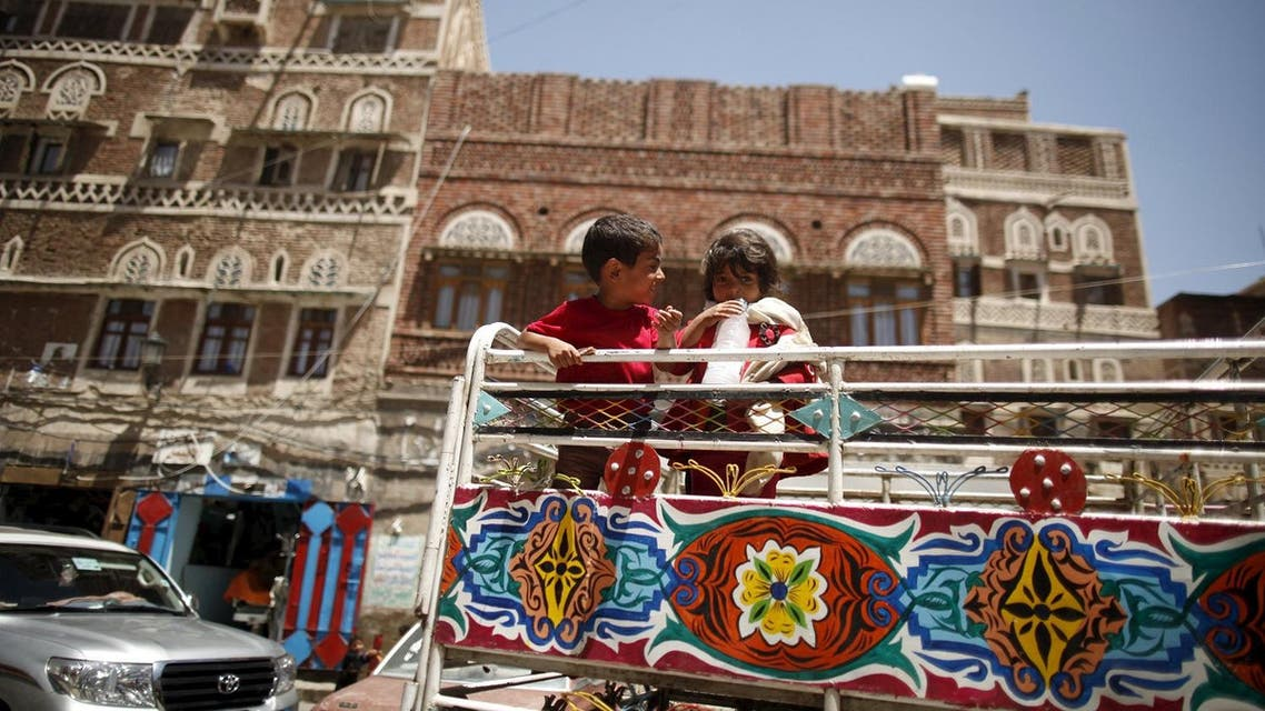 Children ride on the back of a truck during the first day of a ceasefire in Yemen's capital Sanaa. (Reuters)