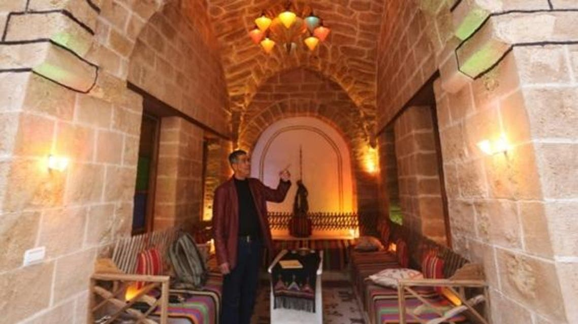 Palestinian university professor Atef Salama stands at his house, a 430-year-old Levantine-style palace, on February 6, 2016, in Gaza City. (File photo: AFP)