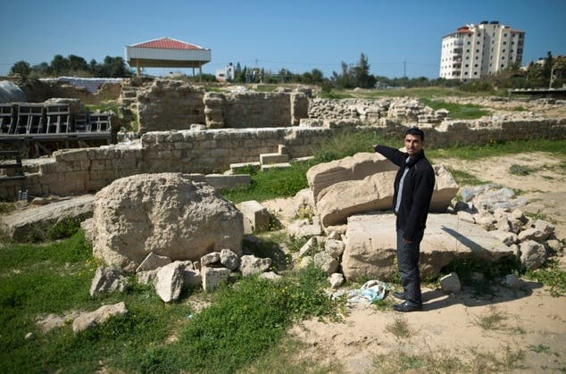 Fadel al-Otol, a Gazan heritage specialist, stands on the ruins of the ancient Saint Hilarion monastery in al-Zawayda, south of Gaza City, on February 28, 2016. (File photo: AFP)