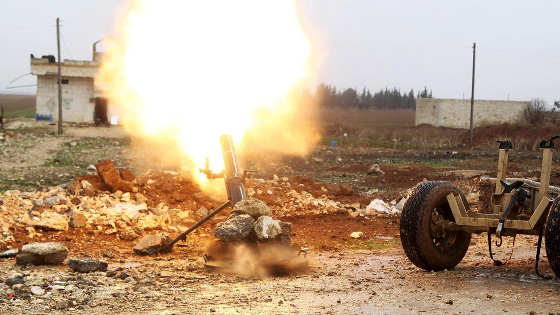 Free Syrian Army fighter fires a shell towards Islamic State fighters in the northern Aleppo countryside, Syria, January 18, 2016. (Reuters)