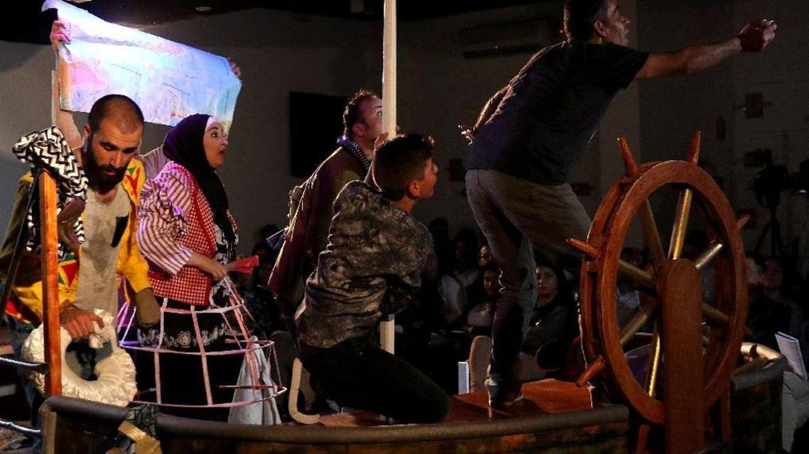 "Syrian refugee actors perform the tragicomedy play ""Love Boat"" at a theatre in the Jordanian capital Amman on April 3, 2016. (AFP)"