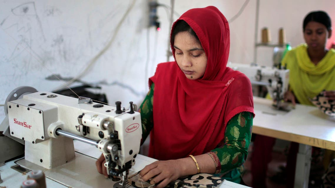 In this Monday, April 20, 2015 photo, Bangladeshi garment workers, who worked at the Rana Plaza garment factory that collapsed two years ago, work at a factory meant to rehabilitate survivors of the accident, the worst in the history of the garment industry, in Savar, near Dhaka, Bangladesh.