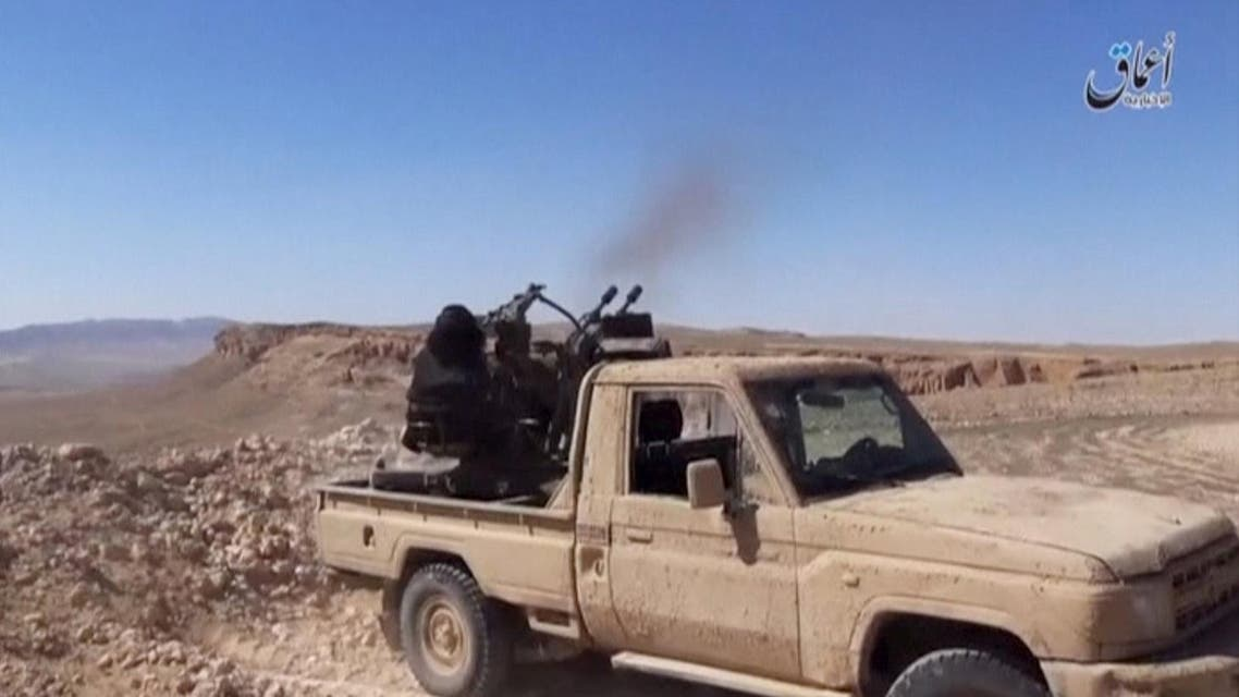 An Islamic State fighter fires an anti-aircraft gun in this still image taken from a video said to be taken on the outskirts of Palmyra and uploaded on March 21, 2016 by an agency affiliated to the Islamic State, as Syrian government forces push their way into Palmyra while the army attempts to recapture the historic city from Islamic State. Social Media Website