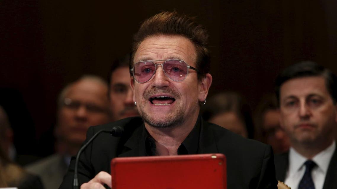 """U2 lead singer Bono testifies before a Senate Appropriations State, Foreign Operations and Related Programs Subcommittee hearing on """"Causes and consequences of violent extremism and the role of foreign assistance"""" on Capitol Hill in Washington April 12, 2016. REUTERS/Yuri Gripas"""