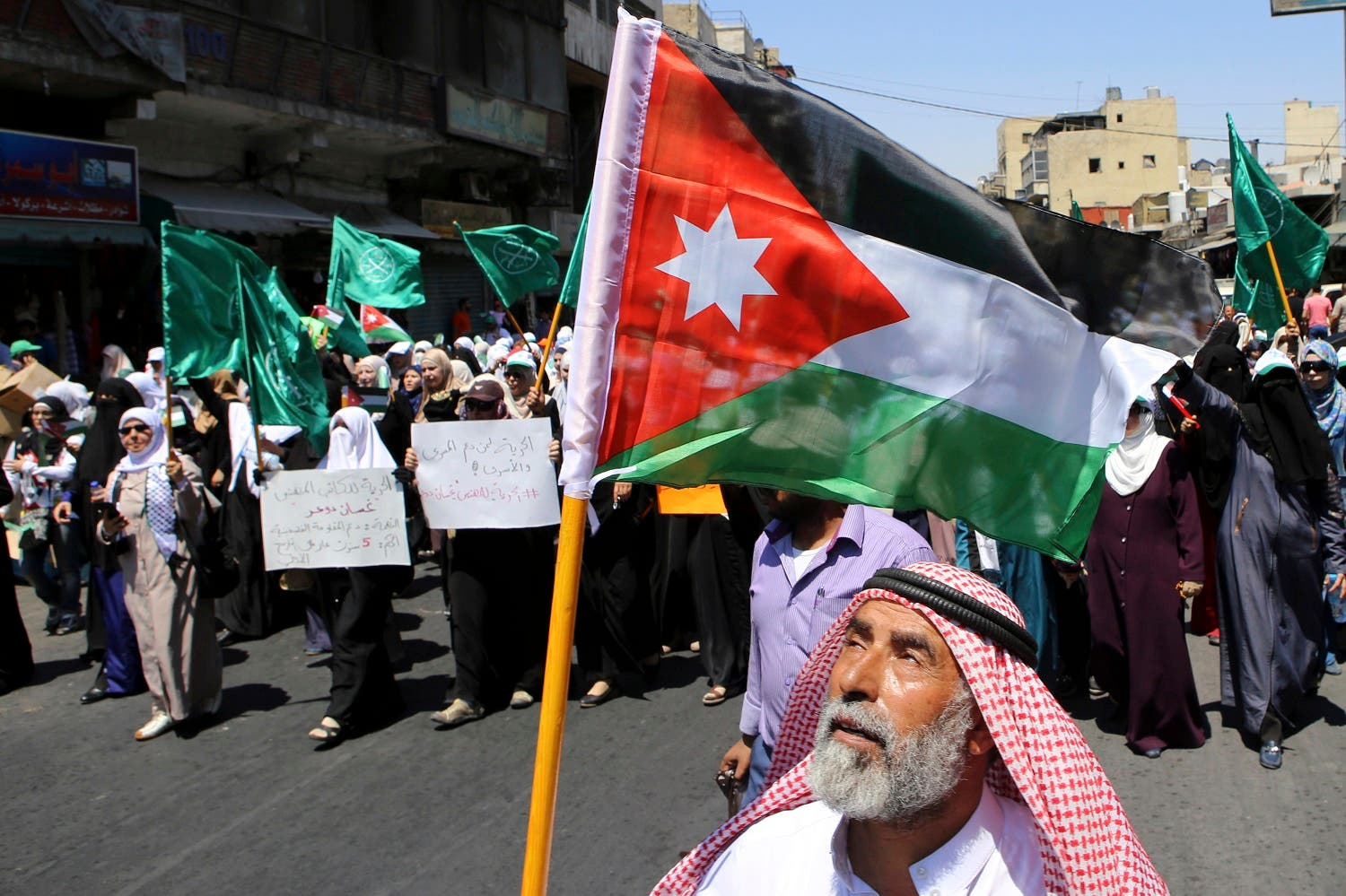 In this July 31, 2015 file photo, a Jordanian protester carries the national flag during a rally by the Muslim Brotherhood, in Amman, Jordan. The Jordan branch recently severed ties with the region-wide movement based in Egypt (File Photo: AP)