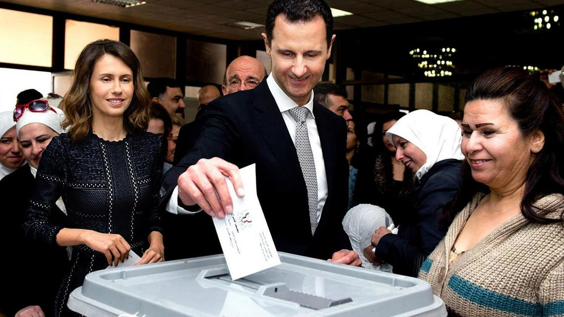 This photo released on the official Facebook page of Syrian Presidency, shows Syrian President Bashar Assad casting his ballot in the parliamentary elections, as his wife Asma, left, is standing next to him, in Damascus, Syria, Wednesday, April 13, 2016 (Photo: Syrian Presidency via AP)