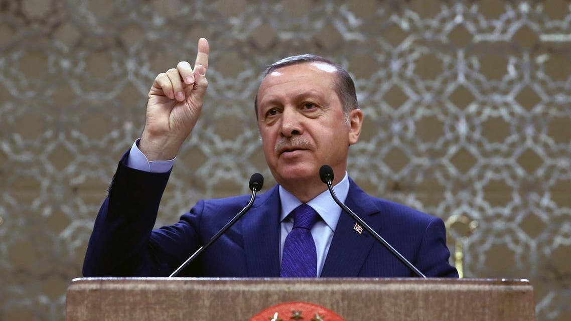Turkish President Recep Tayyip Erdogan addresses a meeting of local administrators in Ankara, Turkey, Wednesday, April 6, 2016. Turkey's Justice Minister Bekir Bozdag says the government will work on a regulation that would allow authorities to strip Turks deemed to be supporting terrorism of their Turkish citizenship. Bozdag's comments on Wednesday came a day after Erdogan called for such a measure to strengthen Turkey's fight against terrorism.(Yasin Bulbul/Presidential Press Service, Pool via AP)
