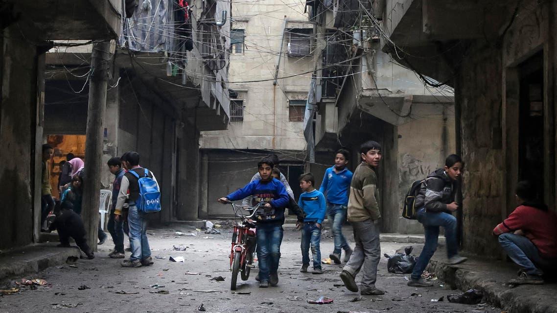 n this Thursday, Feb. 11, 2016 photo, school boys play in a street in Aleppo, Syria.