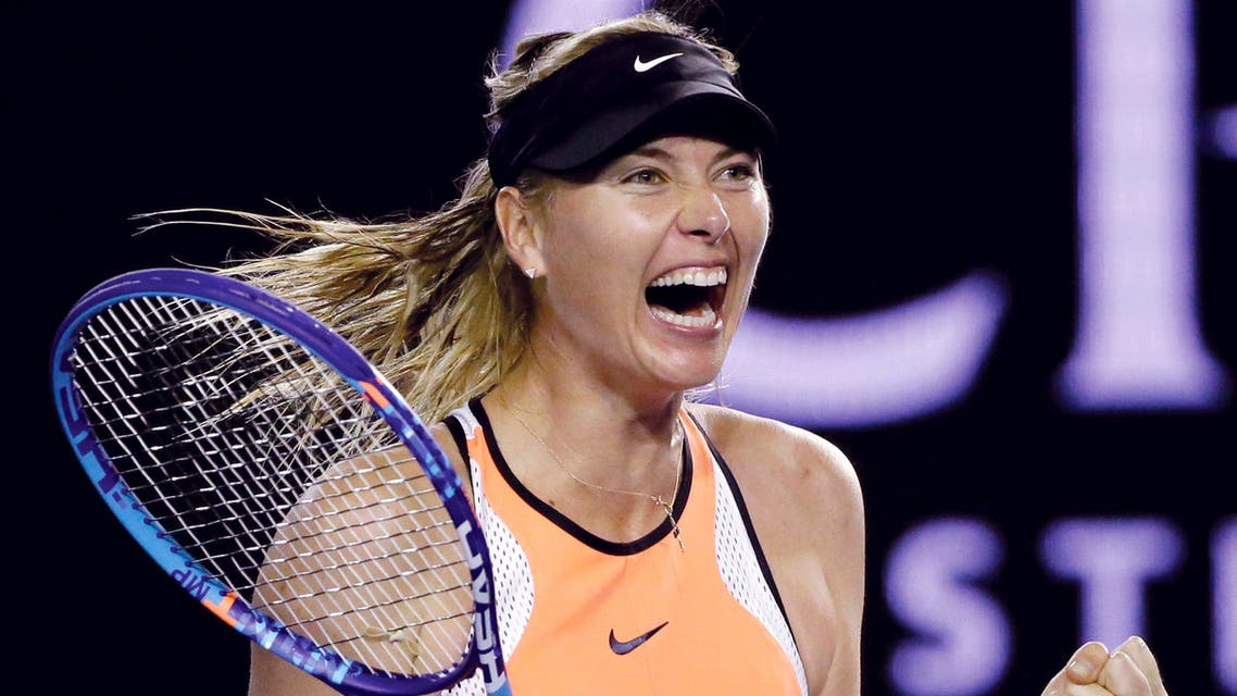 In this Sunday, Jan. 24, 2016, file photo, Maria Sharapova of Russia celebrates after defeating Belinda Bencic of Switzerland in their fourth round match at the Australian Open tennis championships in Melbourne, Australia.