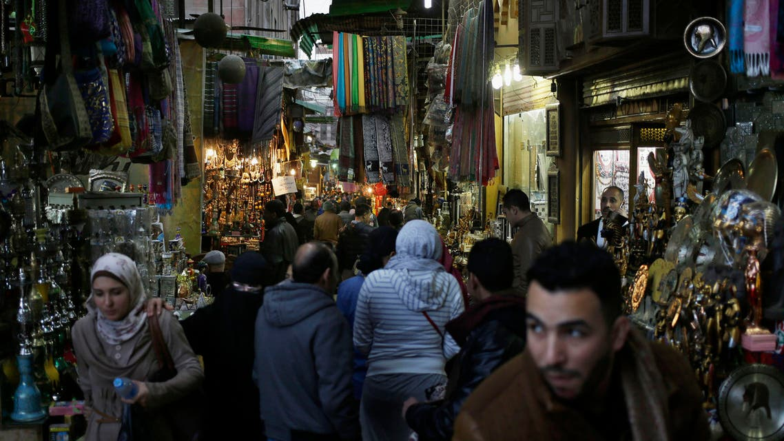 In this Friday, Feb. 20, 2015 file photo, foreigners and Egyptians stroll through the Khan el-Khalili market in Cairo, Egypt.