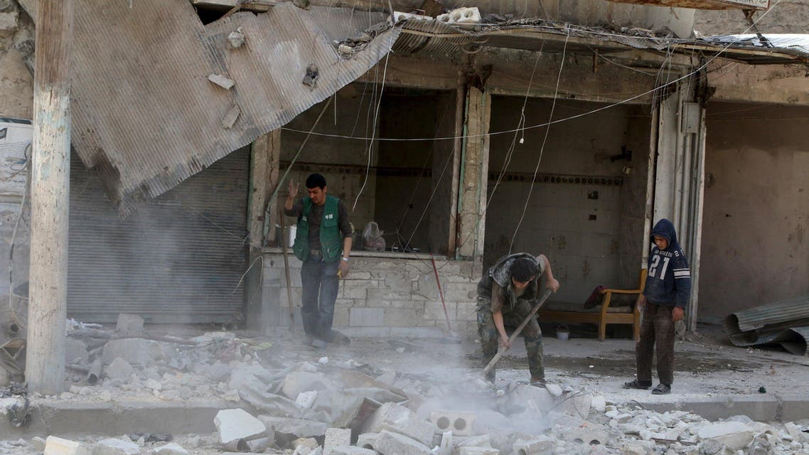 Residents remove debris after an airstrike on the rebel held al-Maysar neighborhood in Aleppo, Syria, April 11, 2016. REUTERS/Abdalrhman Ismail