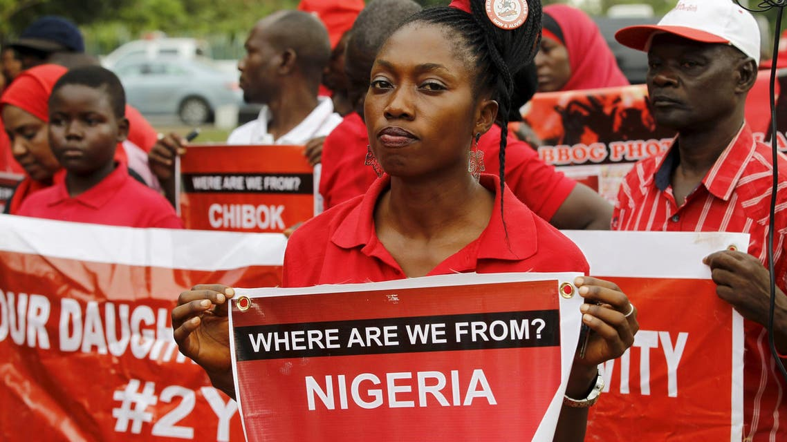Members of the Bring Back Our Girls campaign group take part in a rally on the second anniversary of the abduction of Chibok school girls by Boko Haram, in Abuja, Nigeria, April 14, 2016. REUTERS/Afolabi Sotunde