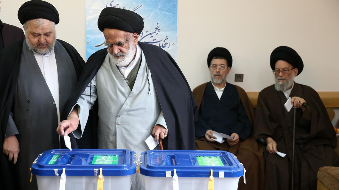 Iranian clergymen vote in the parliamentary and Experts Assembly elections at a polling station in Qom, 125 kilometers (78 miles) south of the capital Tehran, Iran, Friday, Feb. 26, 2016.