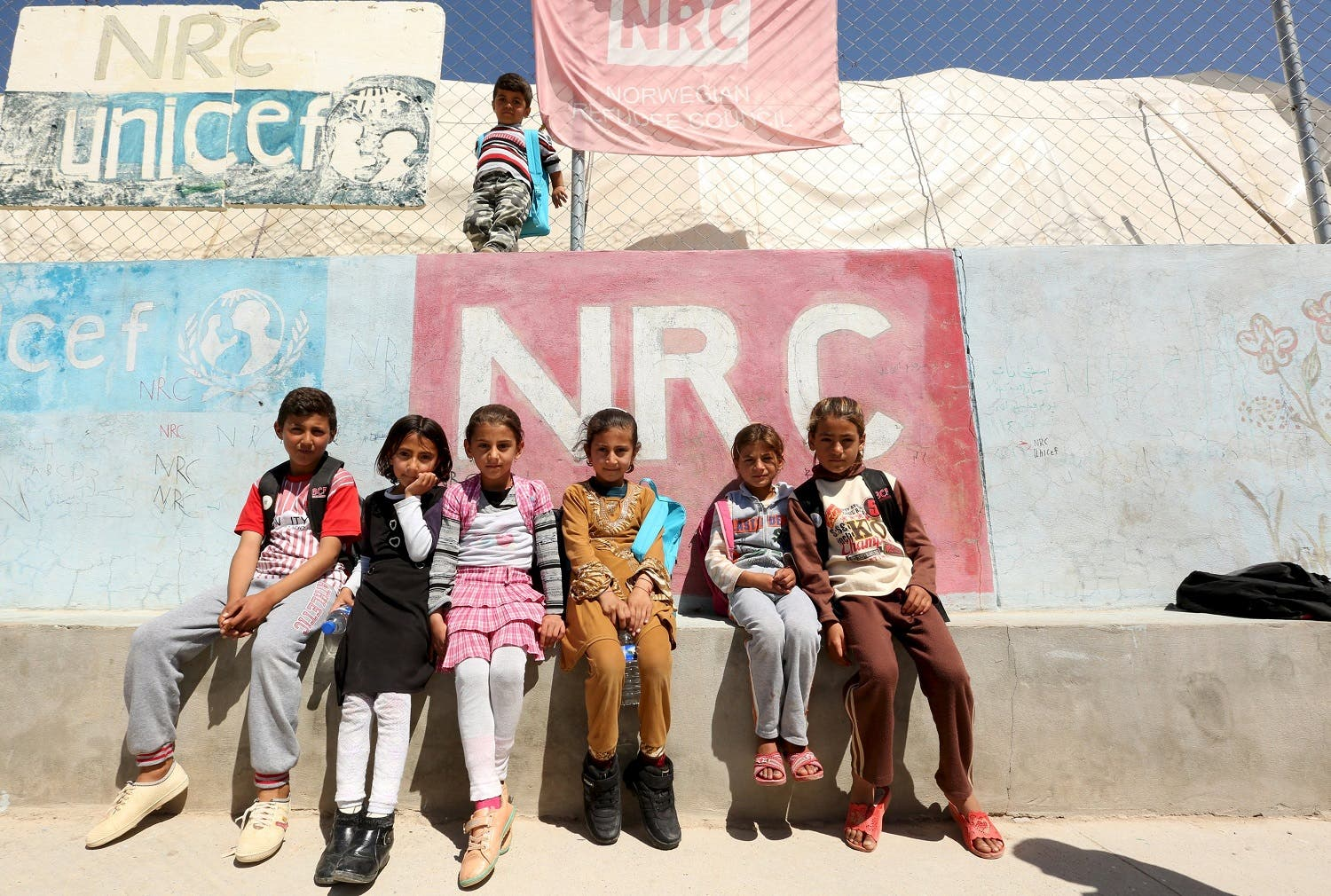 Displaced Iraqi children from the minority Yazidi sect, fleeing violence in the Iraqi town of Sinjar, pose for photographer at a refugee camp on the outskirt of Duhok province. (Reuters)