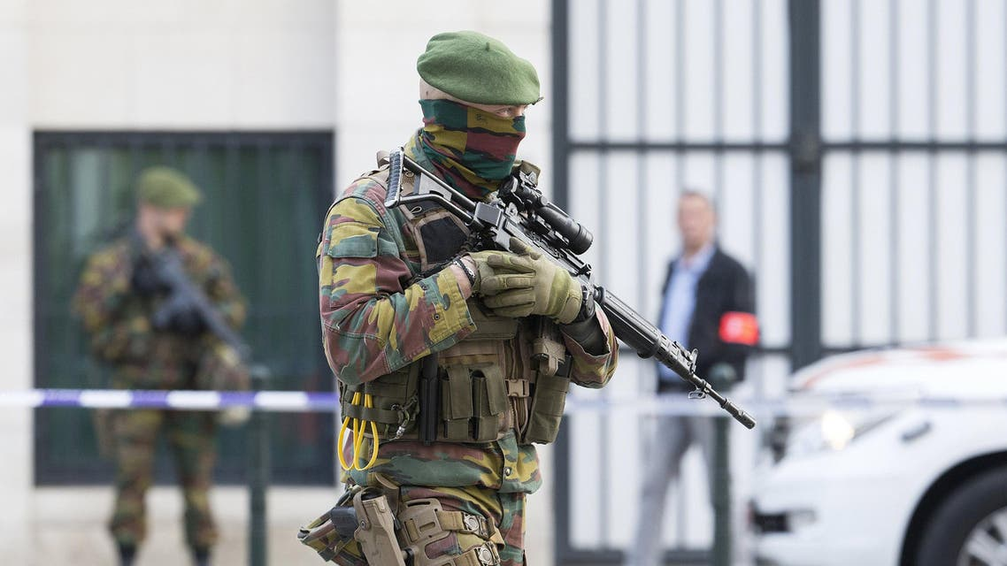 A Belgian special forces police officer and soldiers secure the zone outside a courthouse while Brussels attacks suspects Mohamed Abrini and Osama Krayem appear before a judge, in Brussels, Belgium, April 14, 2016. REUTERS/Yves Herman
