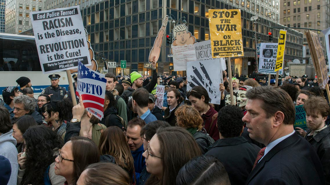 Protesters shout against Republican presidential candidate, Donald Trump, in New York on Thursday, April 14, 2016. (AP)