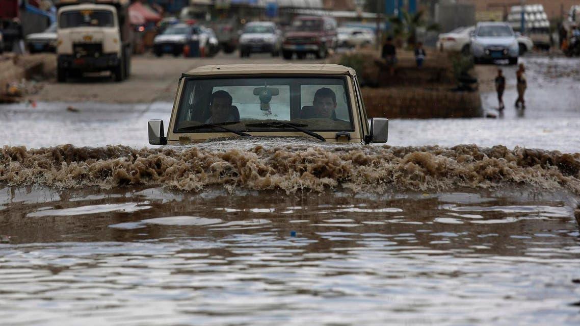 A motorist drives in floodwaters after a heavy rain in Sanaa, Yemen, Wednesday, April 13, 2016. (AP)