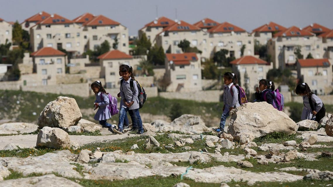 Palestinian bedouin students return from school to their homes near the Jewish settlement of Maale Adumim in the West Bank village of Al-Eizariya, east of Jerusalem March 1, 2016. Reuters