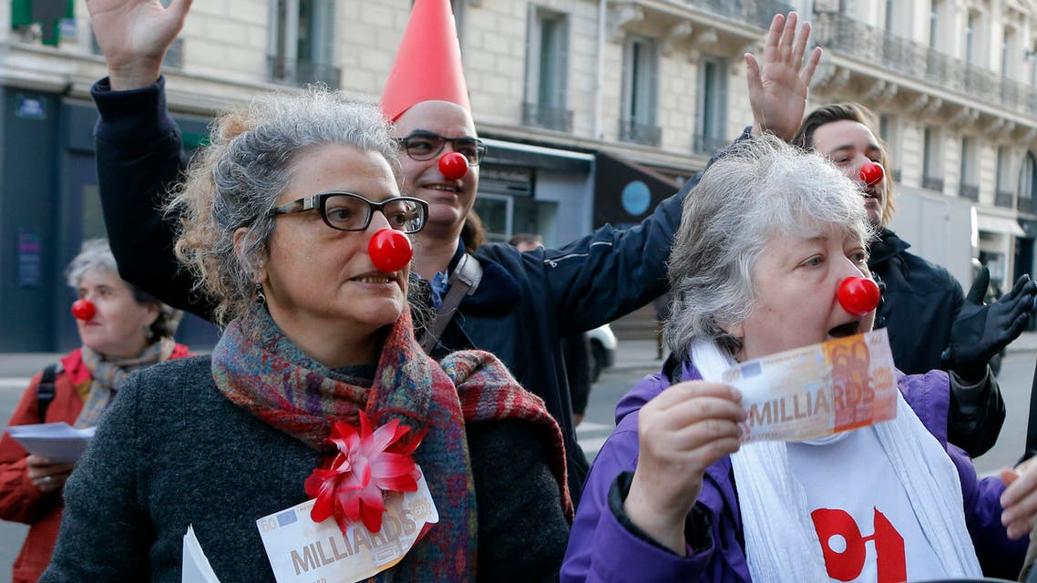 Activists display fake banking notes during a banking managers meeting, in Paris, France, Thursday, April 14, 2016, following the Panama disclosures. (AP)